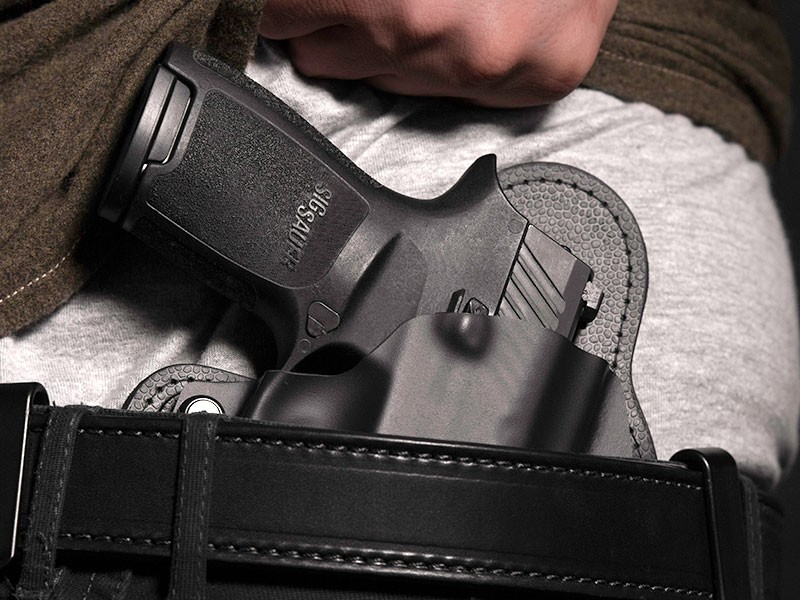 Man Drawing Firearm from Concealed Carry Holster